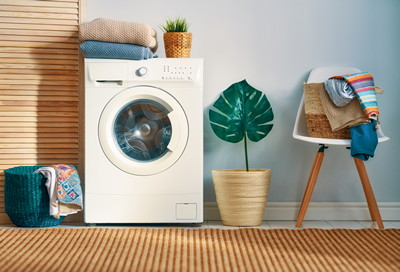 Interior of a real laundry room with a washing machine at home